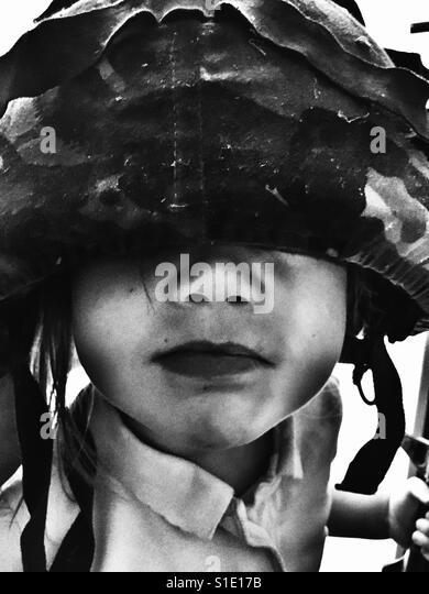 Girl playing Soldiers - Stock-Bilder