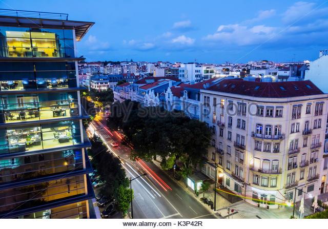 Lisbon Portugal Rua Alexandre Herculano overhead view office building street twilight night time exposure city skyline - Stock Image