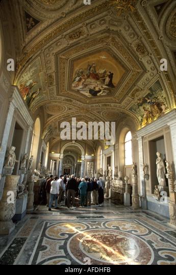 Vatican City Galleria dei Candelabri ceiling art visitors - Stock Image