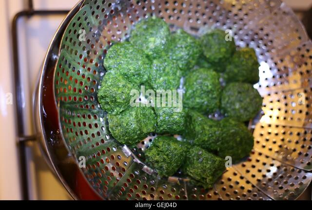 Steaming Spinach. - Stock Image