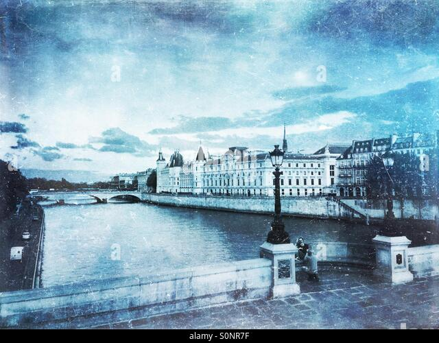 View of the Conciergerie on Ile de la Cite from across Seine River on the Louvre Quay. Frosty, winter-inspired vintage - Stock Image
