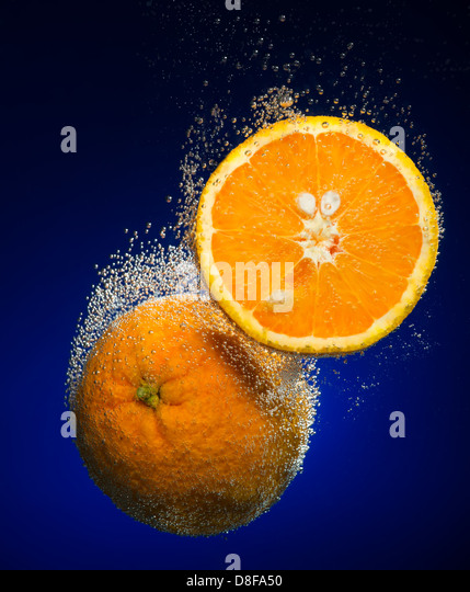 Beautiful orange close-up photo with carbon dioxide bubbles - Stock Image