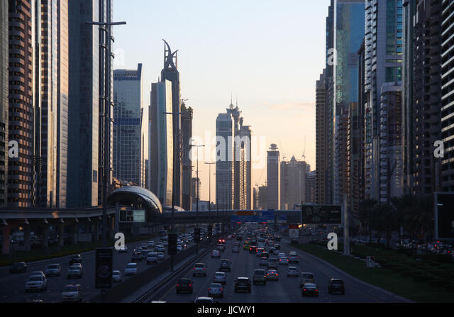The traffic on the main road in Dubai called the Shaikh Zayed Road in the evening. - Stock Image