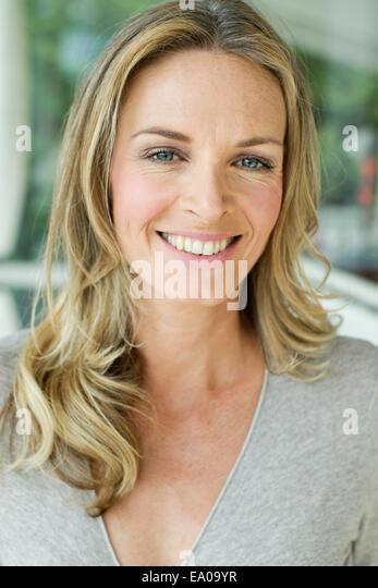 Mature blonde woman, close up portrait - Stock Image