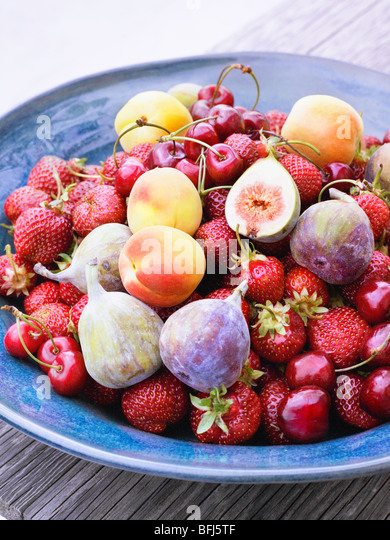 A dish with fruits, Sweden. - Stock Image