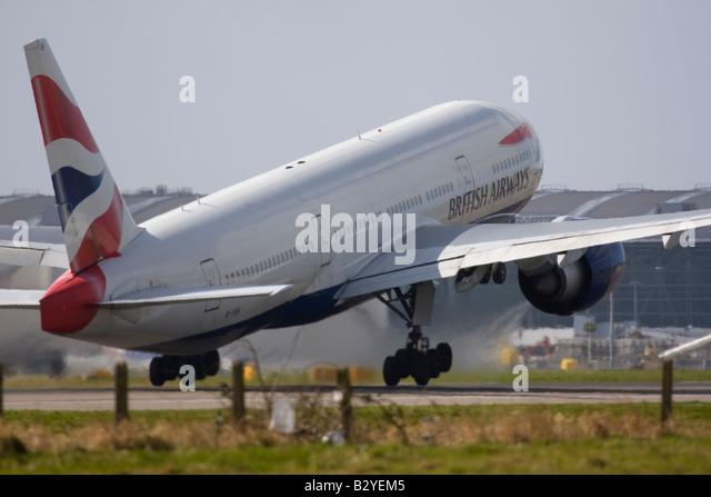 British Airways Boeing 777-236/ER taking off at London Heathrow Airport - Stock Image