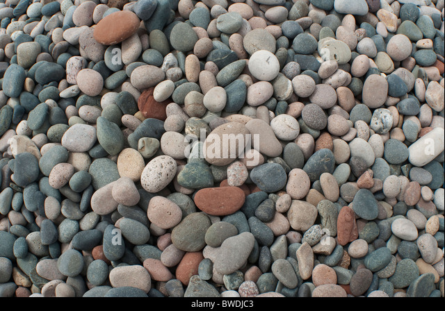 Multi-colored stones on a beach - Stock Image