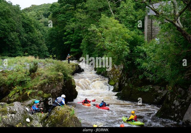kayaking canoeing on the Teifi River at Cenarth  Falls Carmarthenshire Wales Cymru UK GB - Stock Image