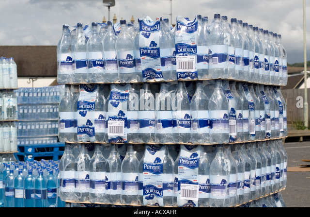 Pallets of bottled water for free distribution at Tesco car park Bishops Cleeve Gloucestershire K - Stock Image