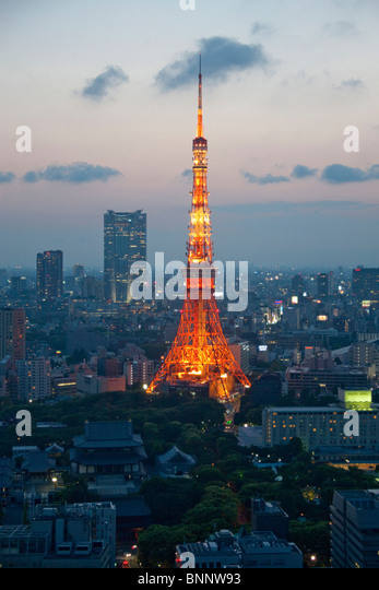 Japan Asia Far East Tokyo building construction Minato Ku Zojoji temple Tokyo Tower television tower night traveling - Stock Image