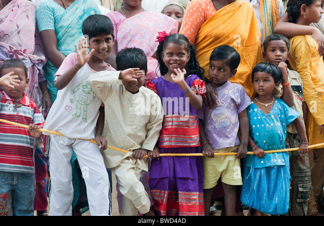 Indian children in a crowd on the street of Puttaparthi, Andhra Pradesh, India - Stock Image