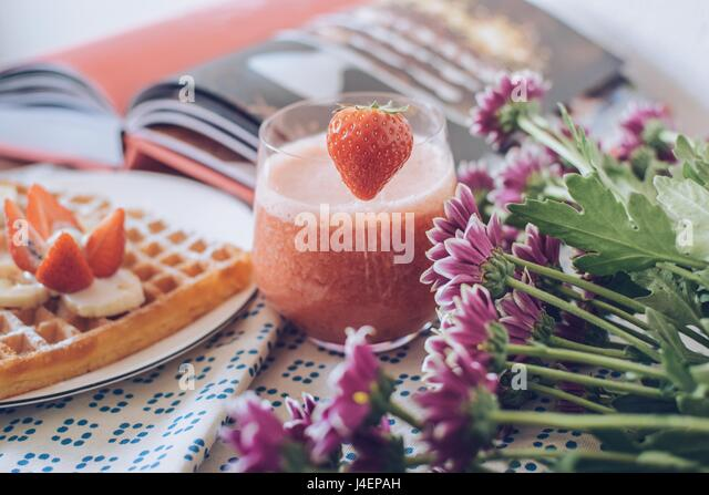 Breakfast variations. Waffles with strawberry smoothie. - Stock Image