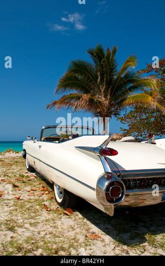 1959 White Cadillac on beach, Varadero, Cuba - Stock Image