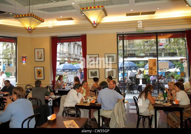 Argentina Buenos Aires Avenida de Mayo Hispanic Bar Iberia business historic cafe dining Hispanic man woman decor - Stock Image