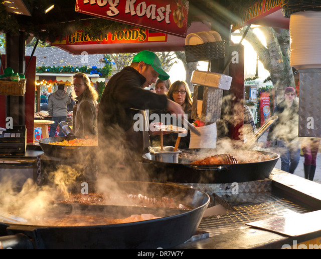 South Bank German Christmas market takeaway food stall and visitors London UK - Stock Image