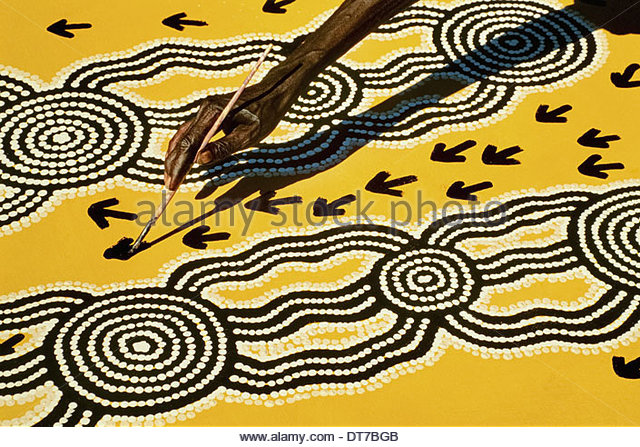 Aboriginal artist at work Central Desert Australia Central Desert Australia - Stock Image