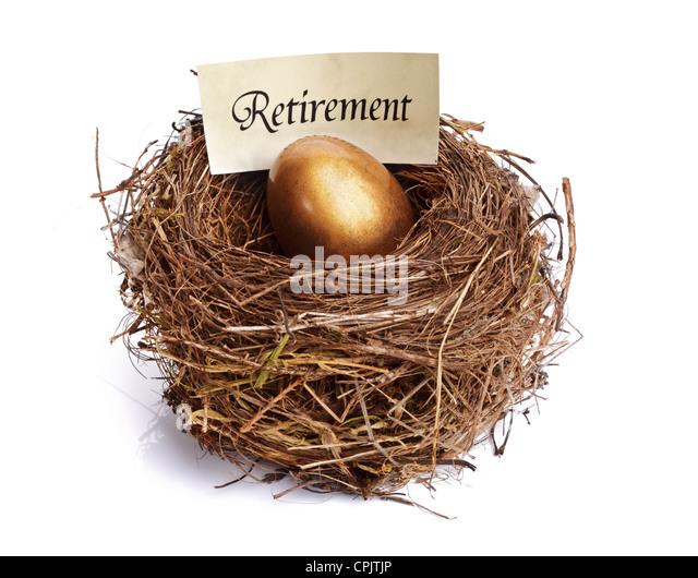 Retirement savings golden nest egg - Stock Image