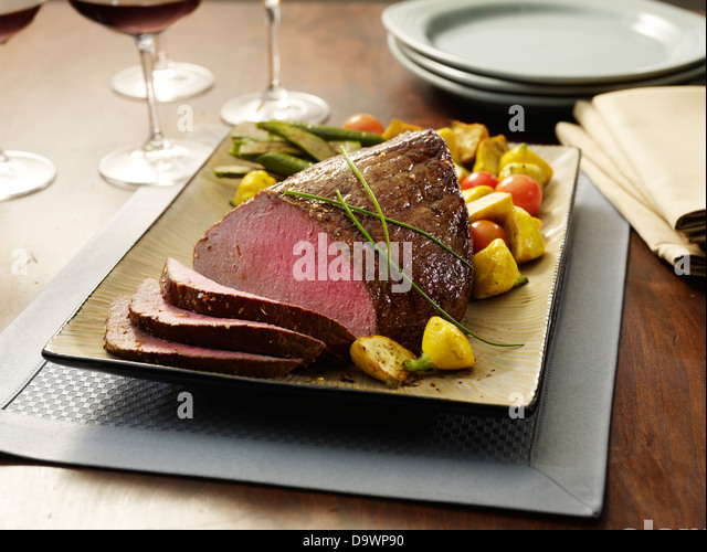 top round roast netted cut - Stock Image