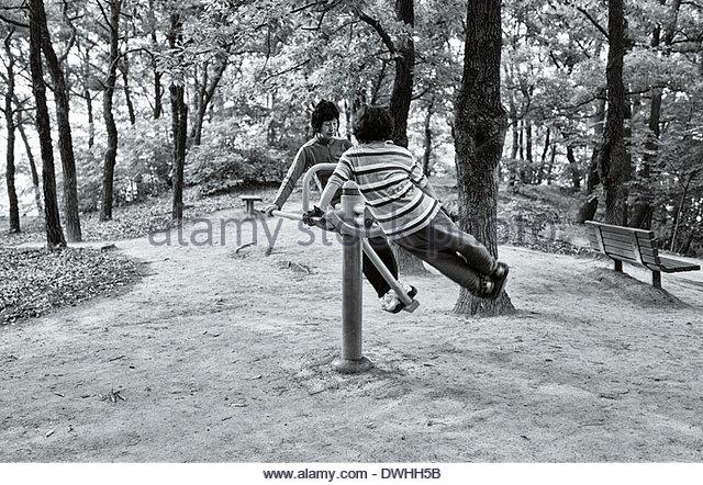 Two Korean ladies exercising, Hoamji Pond, located in Chungju-si, South Korea. - Stock Image