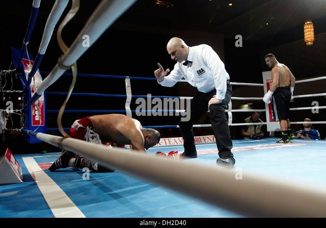 Professional boxing match, referee counting Köksal Orduhan, fight between Enad Licina and Köksal Orduhan, - Stock Image