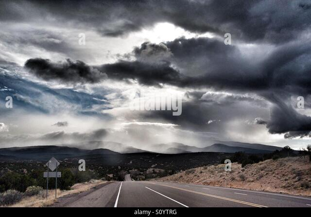 Clouds over Road 14 in New Mexico - Stock Image