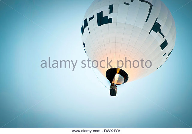 Low angle view of hot air balloon against clear blue sky - Stock Image