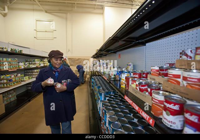 Volunteers Work at Food Pantry - Stock Image