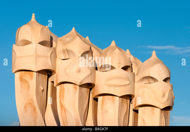 Chimneys on roof of Casa Mila by Antoni Gaudi Barcelona, Spain - Stock Image