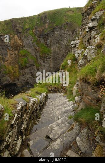 The 'Whaligoe steps' lead down to a natural fishing harbour surrounded by cliffs in Ulbster,  Scotland which - Stock Image