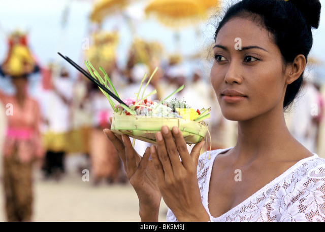 Girl with offerings at a reliqious ceremony in Bali, Indonesia, Southeast Asia, Asia - Stock Image