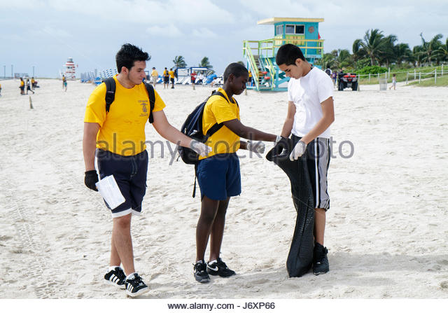 Miami Beach Florida Coastal Cleanup Day volunteer litter trash pollution student US Naval Sea Cadets public beach - Stock Image