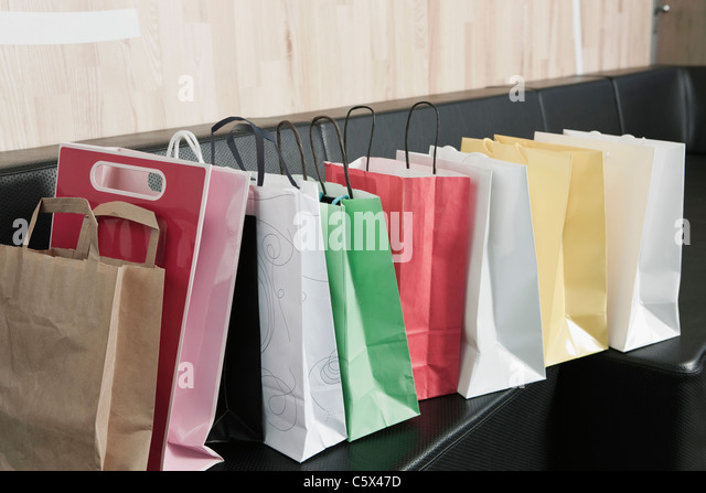 Germany, Cologne, Shopping bags on a bench - Stock Image