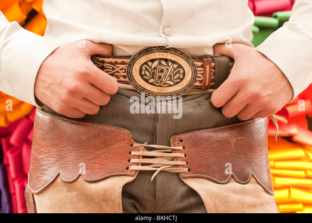 Guadalajara, Mexico, Charro (Mexican Cowboy) with hands resting on belt buckle and chaps, Club Charro Lienzo, Jalisco - Stock-Bilder