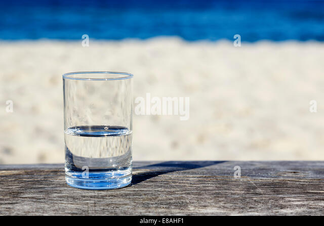 Glass of water which is half-full - Stock Image