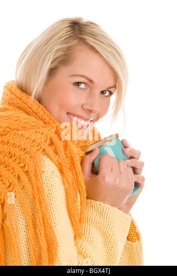 Portrait of young autumnal woman holding mug isolated on white background - Stock Image
