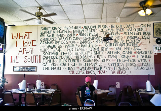 A list of attractions of the Old South are painted on a wall at the Pig Out Inn, a casual dining spot known for - Stock-Bilder