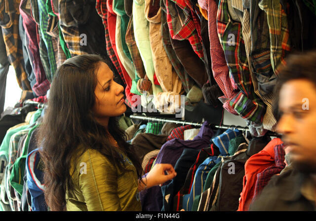 Indian woman shopping for clothes - Stock Image