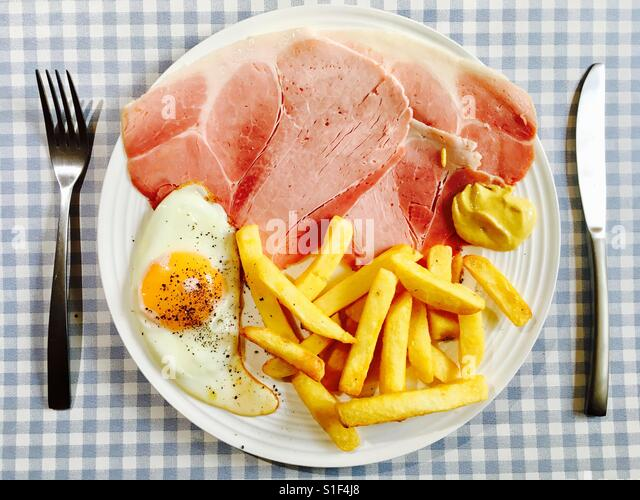 Ham chips and egg with cracked black pepper and English mustard - Stock Image