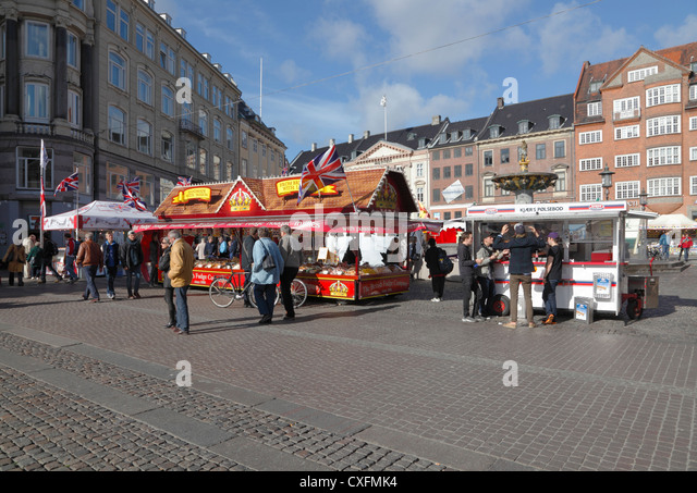 Clash of food cultures. A Danish hot dog stand and the marketing stall of British Fudge Company on Stroeget, Copenhagen, - Stock-Bilder