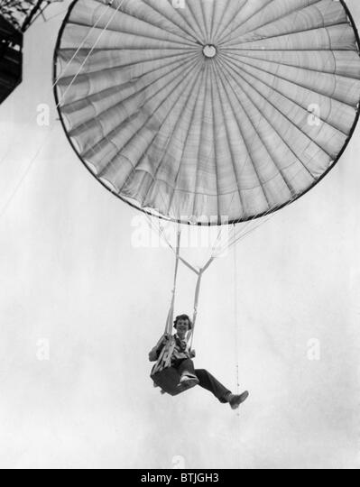 Amelia Earhart helps test a commercial parachute. June 2, 1935. Courtesy: CSU Archives/Everett Collection. Stock Photo