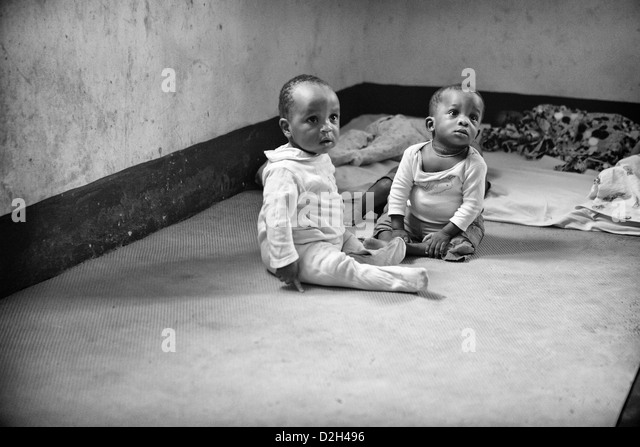 Two small children at a babies home in Uganda. Both of these children had been abandoned at birth. - Stock Image
