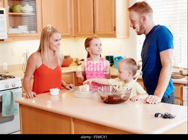 Family baking in kitchen - Stock Image