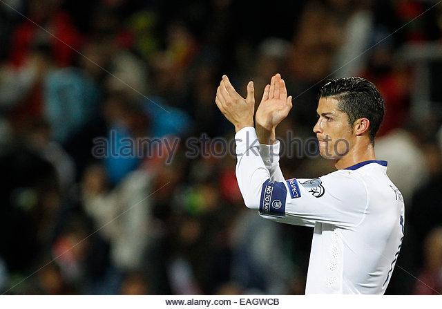 Algarve, Portugal. 14th November, 2014. PORTUGAL, Faro: Portugal's forward Cristiano Ronaldo celebrates after - Stock Image