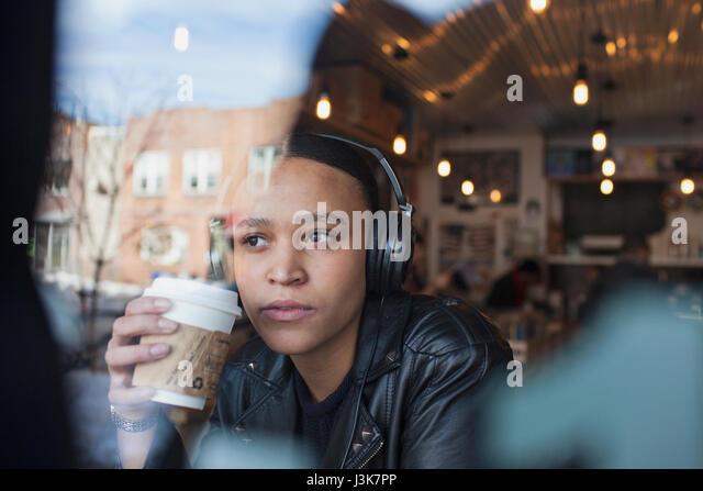 Young woman wearing headphones. - Stock Image