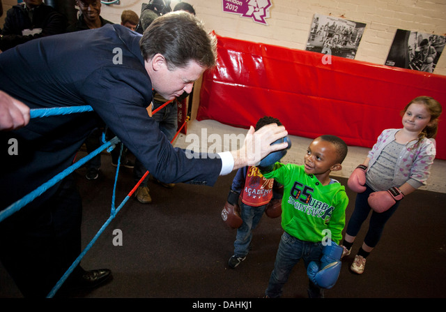 Deputy Prime Minister Nick Clegg  with a child children kids - Stock Image