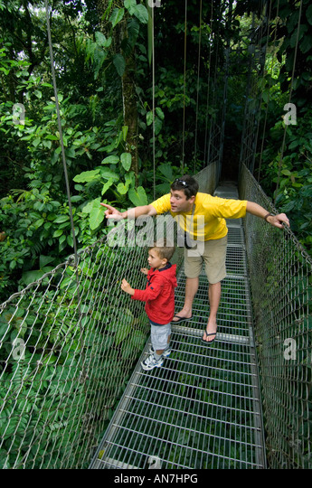 Father and son on Arenal Hanging Bridges, Costa Rica - Stock Image
