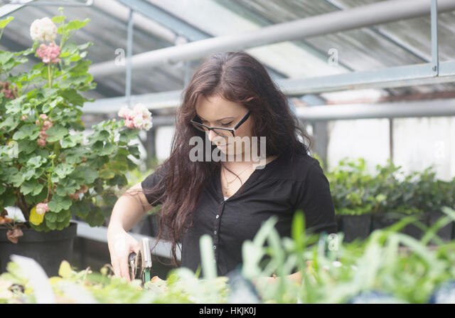 young woman working in freiburg garden stock photos young woman working in freiburg garden. Black Bedroom Furniture Sets. Home Design Ideas