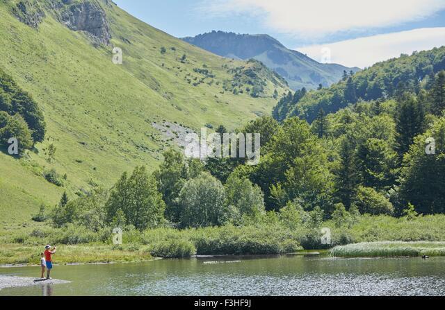 Father and daughter enjoying lake, Valle de Aran, Spain - Stock Image