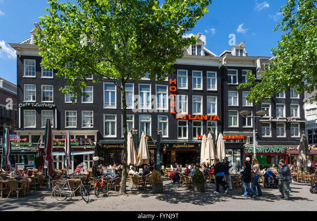 Amsterdam Rembrandtsplein street cafes peole  Netherlands - Stock Image