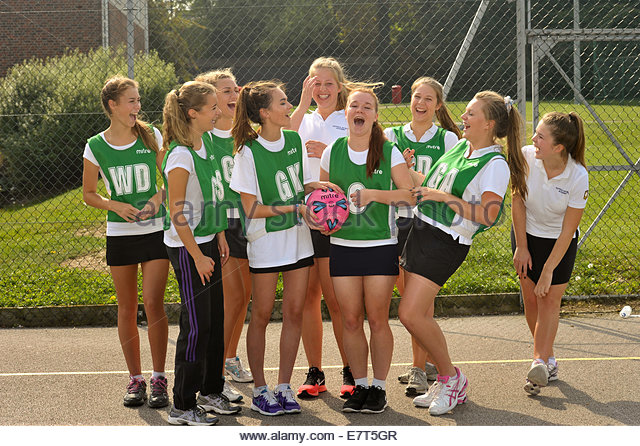 Female comprehensive school pupils dressed for netball - Stock Image